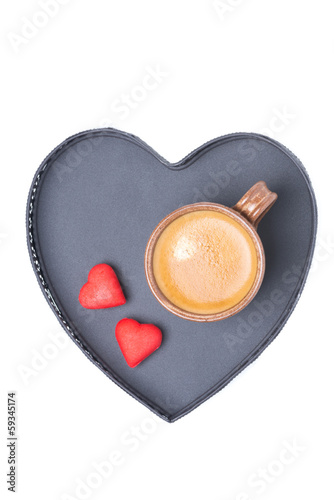espresso cup and candy on a tray in the form of heart, isolated