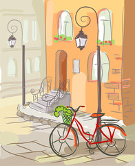 European street with a bicycle and lanterns