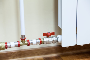 New installed central heating radiator with valve on pipe