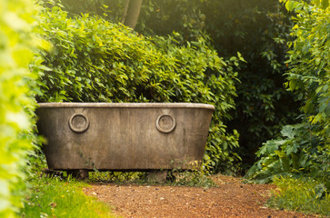 Antique bath in garden