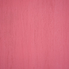 Texture of stone painted in pink color.