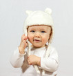baby in white fur hat