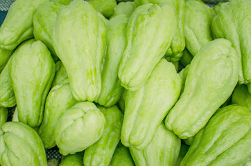 Pile of chayote fruits on the market