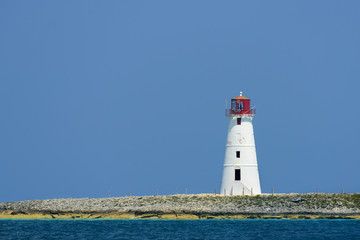 Lighthouse seen from a tiny beach in Nassau - Bahamas.