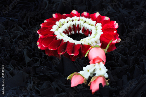 close up of Jasmine Garland with red rose