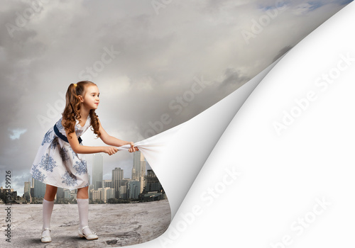 Little girl turning page