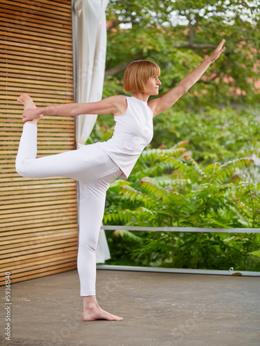 Woman at yoga outside