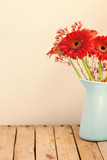 Gerbera daisy flower bouquet over retro background