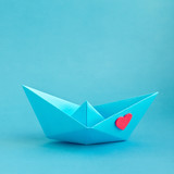 Origami boat with heart. Valentine's day greeting card