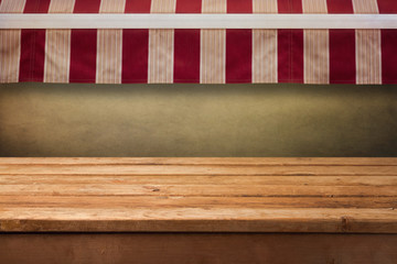Empty wooden table with awning background