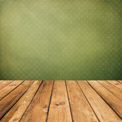 Vintage wooden planks over grunge green background