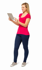 Full Length Of Young Woman Using Digital Tablet
