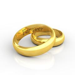 Engraved golden wedding rings on white