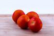 tomatoes on chopping board closeup