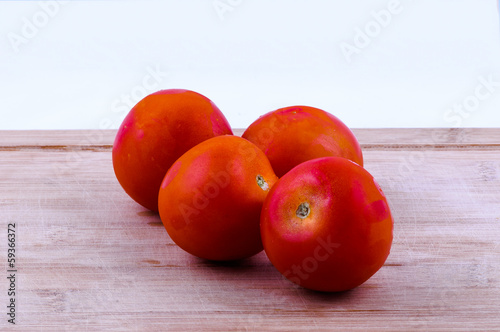 tomatoes on chopping board closeup