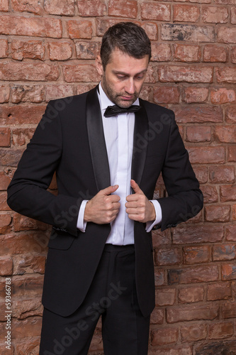 Elegant macho man in a bow tie