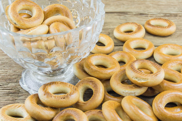 Closeup of a group of assorted bagels on a wood table top with b