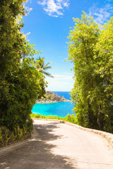 Road to the turquoise ocean and beach in the Seychelles