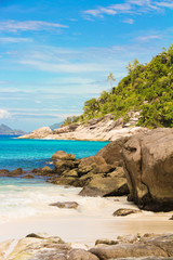 Turquoise exotic lagoon with big stones at Seychelles