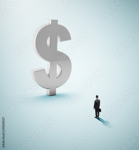 businessman looking at dollar