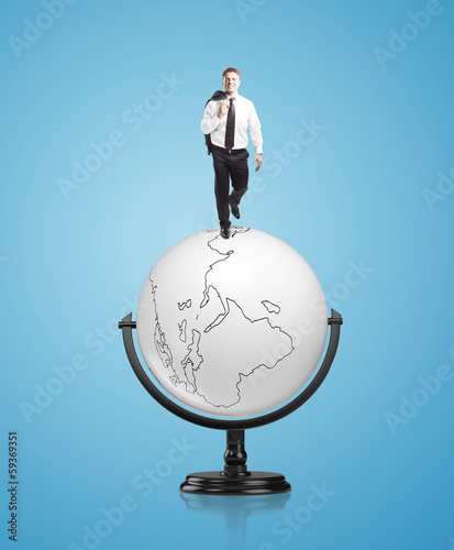 businessman on globe