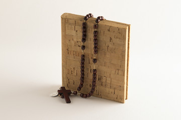 Rosary beads on blank book