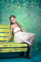 Beatifull teenage girl in vintage dress in studio