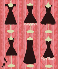 little black dresses on the heart shapes background