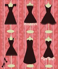 little black dresses on the heart shapes background