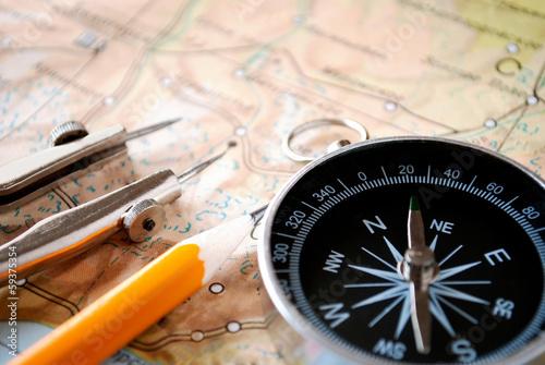 Leinwanddruck Bild Compass and pencil on a map