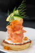 Single Blini appetizer with smoked salmon, caviar and sour cream