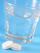 white pills and water