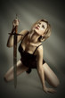 beauty blond woman with sword