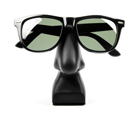 black sunglasses on holder isolated on white