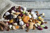 Nuts and dried fruits on vintage wooden boards still life - 59377916