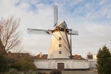 Vintage stone windmill in flanders belgium