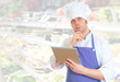 Handsome chef cook using tablet pc. Place for text.