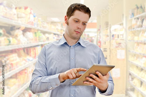 Supervisor with tablet pc in the grocery store