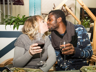 Kissing happy couple: black man and white woman