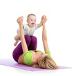 mother with baby boy doing gymnastics
