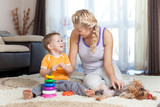 mother and kid have pastime together indoor