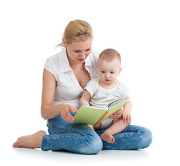 mother reading a book to her baby son
