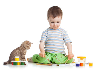 kid drawing paints, cat watching at boy