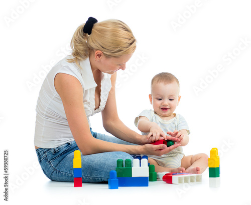 baby and mother play toys together
