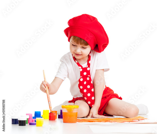 small artist child painting with brush