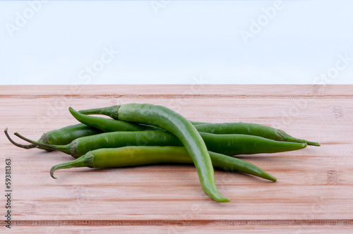 green chillies on chopping board