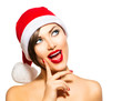 Christmas Woman. Beauty Model Girl in Santa Hat over White