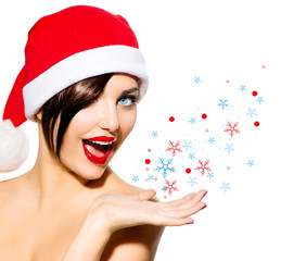Christmas Woman. Beauty Girl in Santa Hat isolated on White