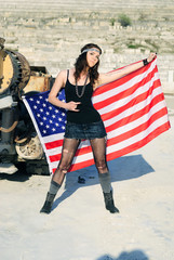bright girl amongst stone captive with american flag