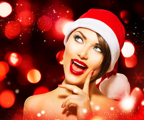 Christmas Woman over Glowing Holiday red Background